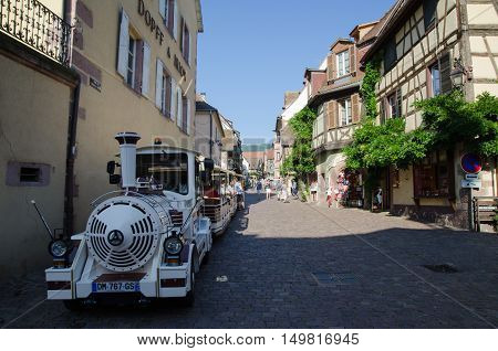 RIQUEWIHR, FRANCE - SEPTEMBER 13:  Sightseeing train at the main street Rue du General de Gaulle in the village Riquewihr in Alsace in France by the Alsace wine route on September 13, 2016.
