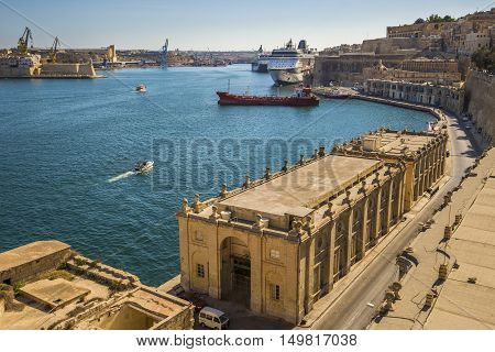 Valletta Malta - The Grand Harbour of Malta with cruise ships motorboats and clear blue sky