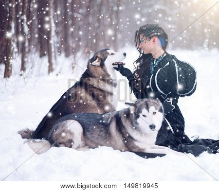 Attractive Woman With The Dogs.