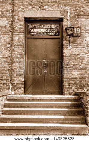OSWIECIM POLAND - MAY 12 2016: Door block in concentration camp Auschwitz-Birkenau in Oswiecim Poland.