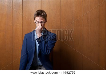 Young Man Adjusting Eyeglasses