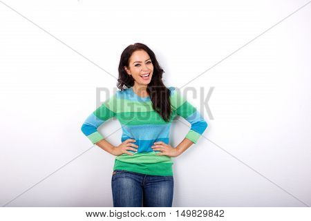 Woman Smiling With Hands On Hips Against White Background