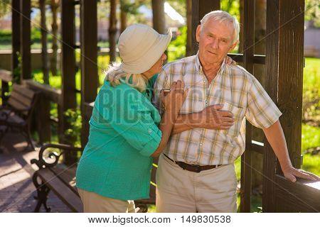 Senior man has heart ache. Elderly couple outside. I feel pains again. Husband has chronic illness.
