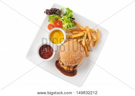 Top view of American style barbecue pork burger set including french fries ketchup mustard sauce garnished with fresh vegetables in caramic dish isolated on white background