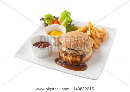 Front view of American style barbecue pork burger set including french fries ketchup mustard sauce garnished with fresh vegetables in caramic dish isolated on white background