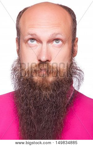 Portrait of the young bald thinking man with beard looks up. isolated on white.