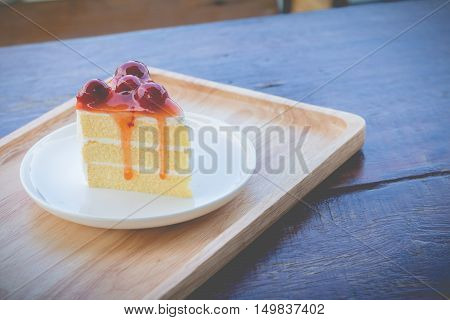 Sponge cake with cherry syrup. Peace of cherry cake served in afternoon time.