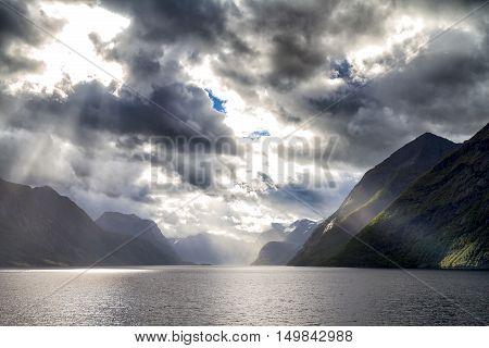 Sunbeam at the dramatic Hjorundfjord Fjordland, Norway