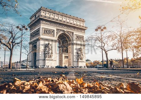 Arc de Triomphe located in Paris in autumn scenery.