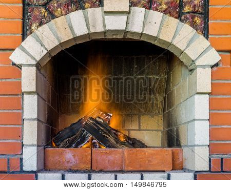 Fire in fireplace. Close Up of firewood burning in fire. Fireplace in the house. A fireplace in a country house