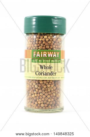 NEW YORK NY - OCTOBER 1st 2016: Fairway brand Whole Coriander seeds in glass spice bottle