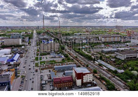 Tyumen, Russia - May 19, 2015: Aerial view on Permyakova and Harkovskaya streets intersection. On foreground: Ochakovo factory, Perestroyka trade center, Construction yard shop