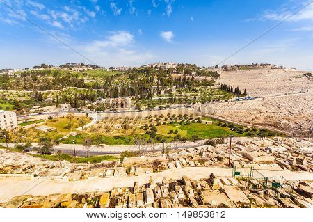 Mount of Olives and the old Jewish cemetery in Jerusalem, Israel. Gethsemane and Church of Mary Magdalene foreground.