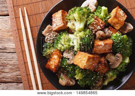 Fried Tofu Cheese With Broccoli, Mushrooms And Teriyaki Sauce Close-up. Horizontal Top View