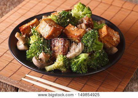 Fried Tofu Cheese With Broccoli, Mushrooms And Teriyaki Sauce Close-up. Horizontal