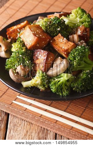 Fried Tofu Cheese With Broccoli, Mushrooms And Teriyaki Sauce Close-up. Vertical
