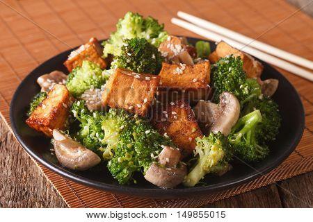 Vegetarian Stir Fry: Tofu With Broccoli, Mushrooms And Sesame Closeup. Horizontal