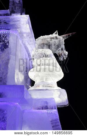 PERM RUSSIA - JAN 4 2016: Illuminated unicorn in Ice town Ice town in Perm - traditional winter attraction
