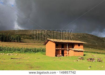 Nice adobe brick house northern Peru. Nice evening light and clouds.