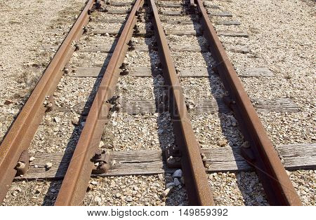 unused narrow gauge railway line with sleepers and and nails in tact