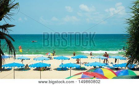 Phuket, Thailand. April 13, 2016. Tourists on Kata beach on a sunny day.