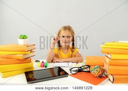 school and homework concept, little girl have an idea with copyspace