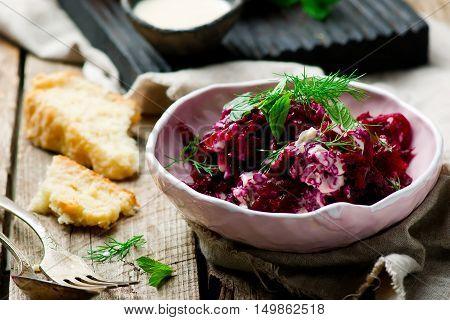 Beet salad with tahina sauce .selective focus