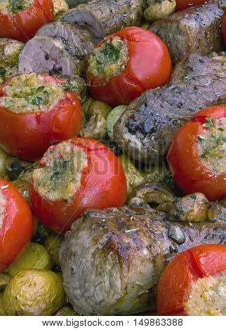 grilled pork tender loin with vegetables in provencal style