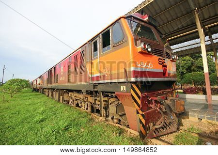 CHIANGMAI THAILAND - MARCH 10 2012: Ge Diesel locomotive no.4540 and train no.14 from chiangmai to bangkok. Photo at Chiangmai railway station.