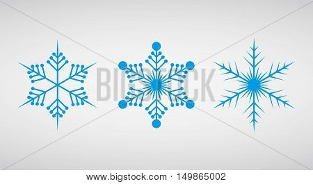 Snowflake icon graphic. Blue snowflakes on light background . Set of icons of snowflakes. Vector illustration.