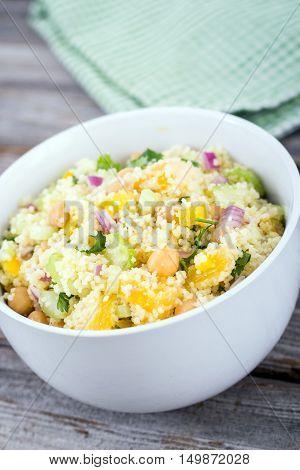 citrus couscous salad with chick peas bowl