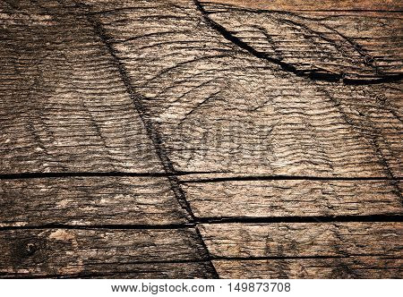 abstract background or texture Old wooden board with notches by sawing