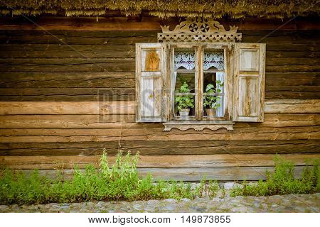 beautiful old window in the old wooden house