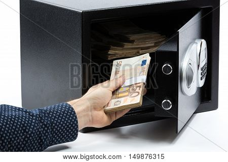 Male Hand Keeping Euro Banknotes In A Safe Deposit Box