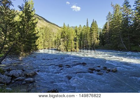 Early evening on a mountain river. The Kucherla river Altai Mountains Russia.