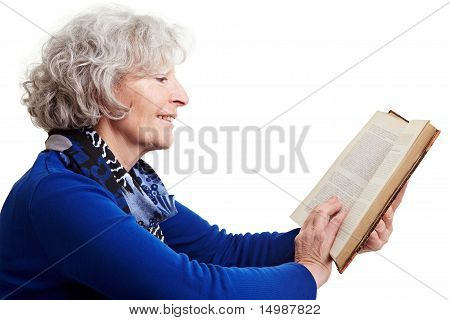 Senior Woman Reading A Novel