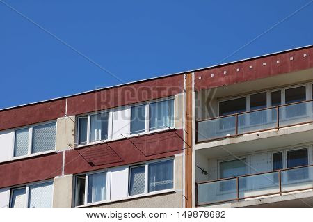 Detail of top of the prefabricated house two last floors of prefab also panel house with balcony and sky above