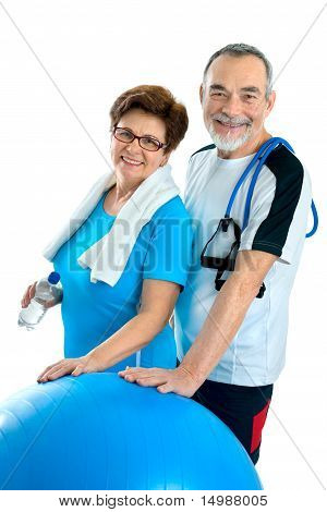 Smiling elderly couple working out in gym. Isolated on white poster