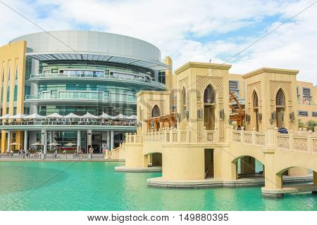 Dubai, UAE - May 1, 2013: close up of the bridge that connects the Dubai Mall to Souk Al Bahar in the Burj Khalifa Lake. The area of the Burj Khalifa is famous for the shopping.