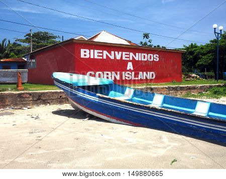 building on beach with welcome sign Brig Bay Big Corn Island Nicaragua