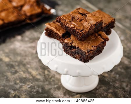 homemade chocolate brownies on a dessert plate and coffe