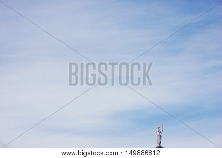 SAINT PETERSBURG RUSSIA. Petropavlovskaya fortress. Sculpture allegory navigation - statue of a woman with the paddle on the rooftop Botnia house on a background of blue sky.