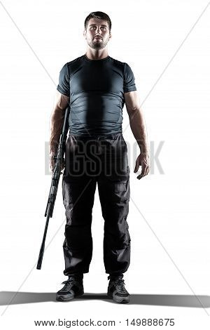 man in black military uniform holding rifle isolated on white background