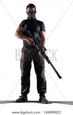 man in mask black military uniform holding rifle isolated on white background