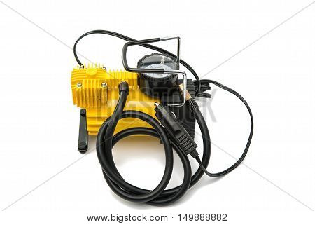 The automobile compressor isolated on a white background