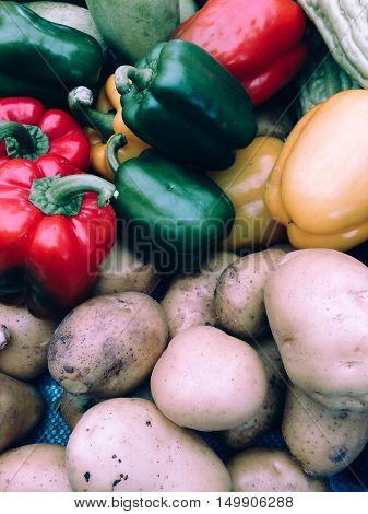 Closeup view of fresh potato and sweet pepper, view group of many potato and sweet pepper, potato and sweet pepper background