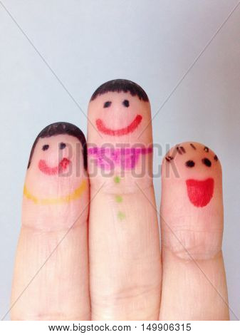Happy family concept : Finger puppets of loving mother and father with young child