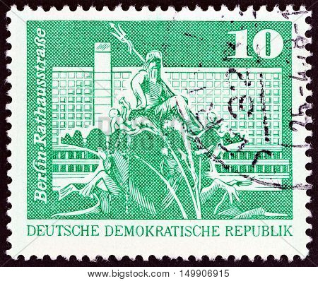GERMAN DEMOCRATIC REPUBLIC - CIRCA 1973: A stamp printed in Germany shows Neptune Fountain and Rathausstrasse, Berlin, circa 1973.