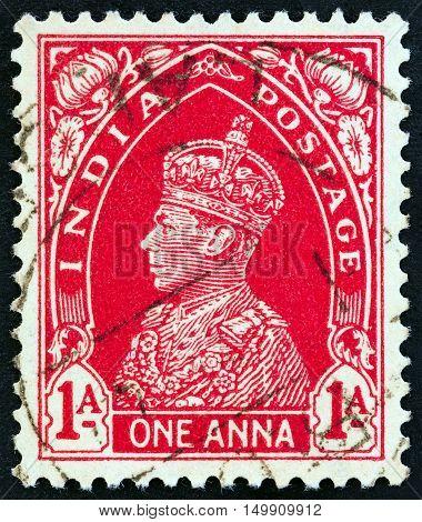 INDIA - CIRCA 1937: A stamp printed in India shows King George VI, circa 1937.