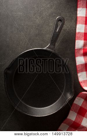 frying pan and napkin on black background